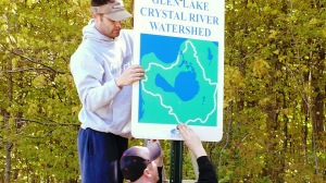 John Hayes and Friend installing Watershed Marker Signs